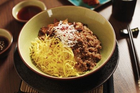 Assorted vegetable and minced beef on top of rice in a bowl photo