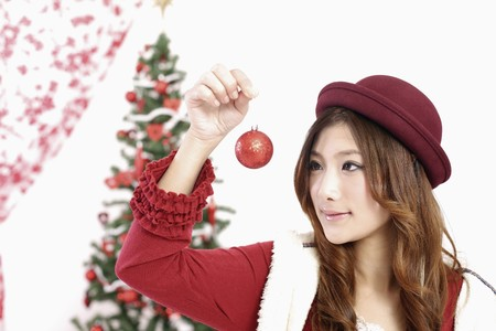 Woman looking at Christmas bauble photo