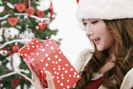 Woman looking surprised at gift boxes photo
