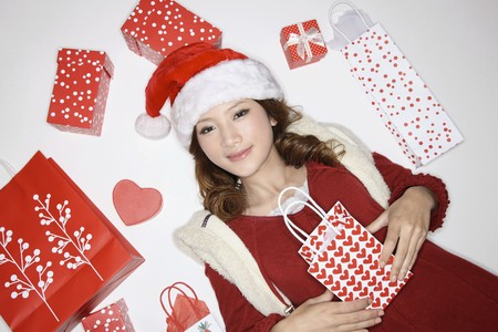 Woman surrounded by Christmas gifts and shopping bags photo