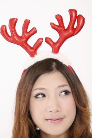 Woman wearing reindeer antler photo