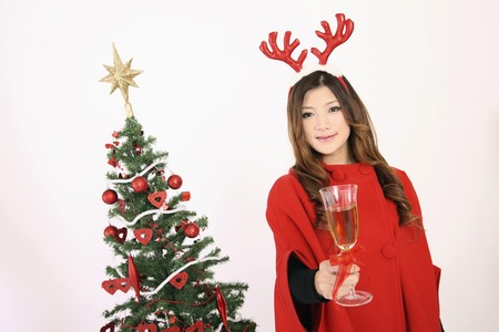 Woman wearing reindeer antler holding a glass of champagne Stock Photo - 8148511