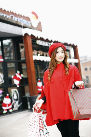 Woman carrying shopping bags photo