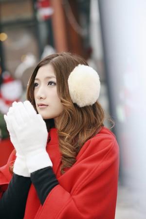 ear muffs: Woman wearing ear muffs and gloves