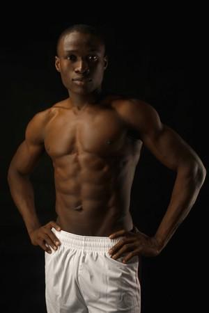 arms akimbo: Shirtless man with arms akimbo Stock Photo