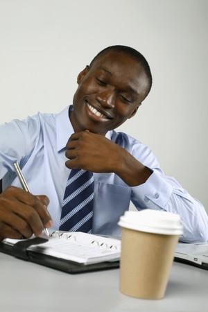 Businessman writing on organizer photo