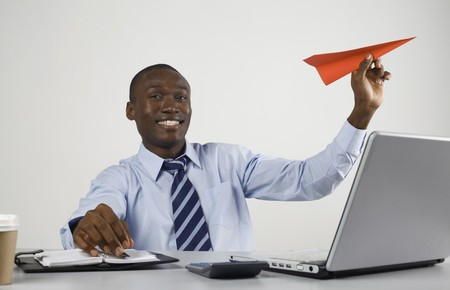 Businessman playing with paper airplane Stock Photo - 8148169