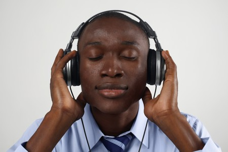 Businessman listening to music on the headphones photo