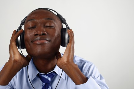 Businessman listening to music on the headphones Stock Photo - 8148262