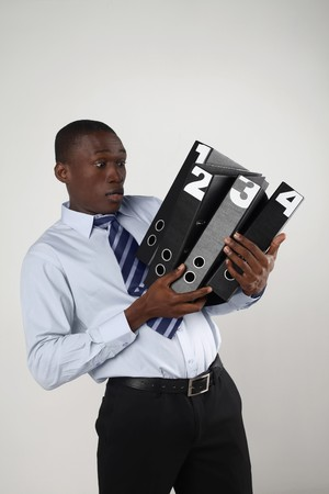 Businessman carrying a stack of folders photo