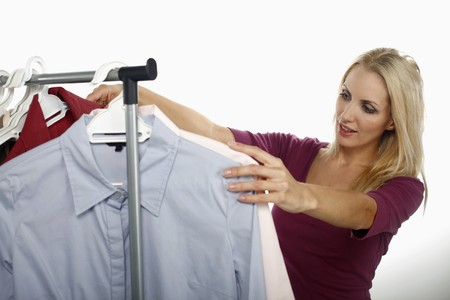 Woman looking through clothes rack Stock Photo - 8148028