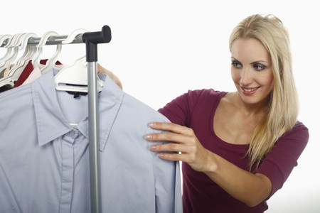 Woman looking through clothes rack Stock Photo - 8148037