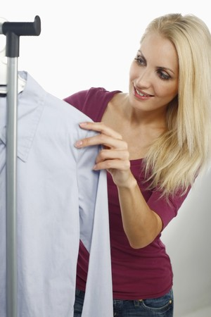 Woman looking through clothes rack Stock Photo - 8148241