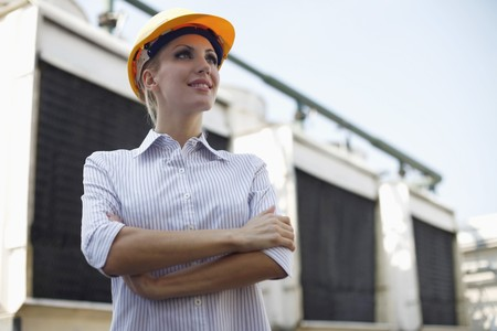 Female architect standing with her arms crossed Stock Photo - 8148092