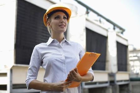 female architect: Female architect with clipboard Stock Photo