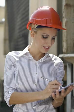 Female architect writing report Stock Photo - 8148809