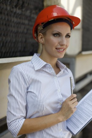 belarusian ethnicity: Female architect holding pen and clipboard