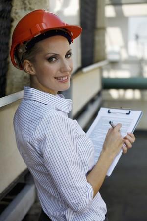 Female architect writing report Stock Photo - 8148880