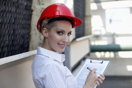belarusian ethnicity: Female architect writing report Stock Photo