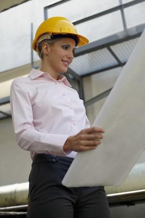 belarusian ethnicity: Female architect holding blueprint