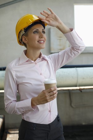 belarusian ethnicity: Female architect holding a cup of coffee