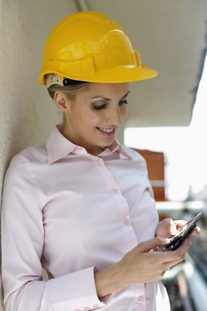 belarusian ethnicity: Female architect text messaging on the phone Stock Photo