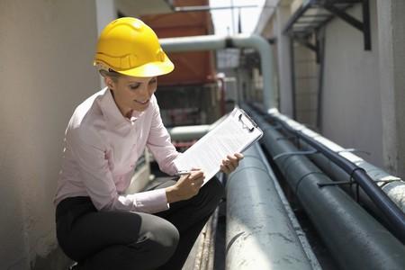 Female architect checking the pipeline photo