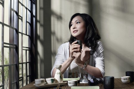 Woman holding a cup of tea photo