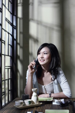 Woman smiling while talking on the phone photo