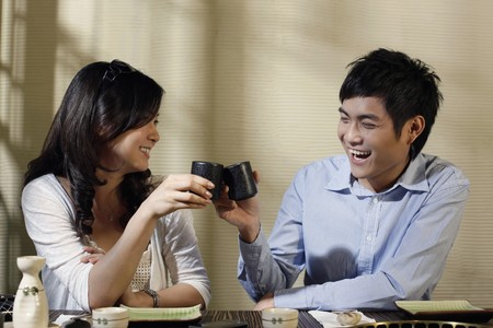 Man and woman toasting drinks Stock Photo - 8149254
