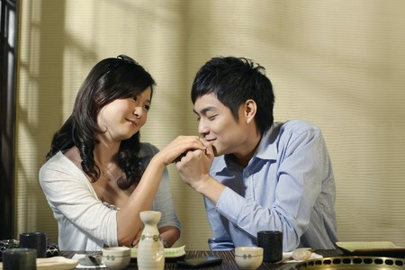 Man kissing womans hand photo