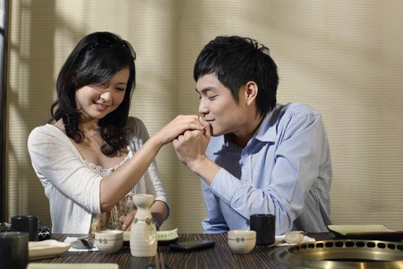 Man kissing woman's hand Stock Photo - 8149243
