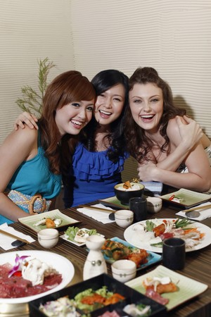 Women posing in a restaurant Stock Photo - 8149039