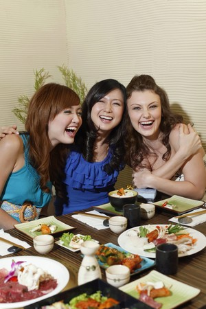 Women having fun in a restaurant photo