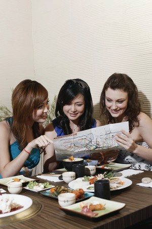 Women reading map in a restaurant photo