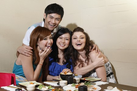 Man and women in a restaurant, laughing photo