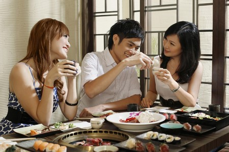 Man and women having fun in a restaurant photo