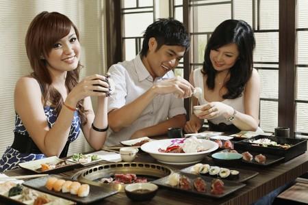 sake: Man and women having fun in a restaurant