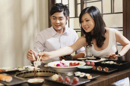 Man and woman grilling meat Stock Photo - 8148454