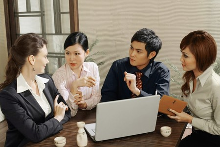 Business people having discussion in a restaurant Stock Photo - 8149260