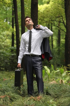 Businessman with briefcase and coat Stock Photo - 8149301