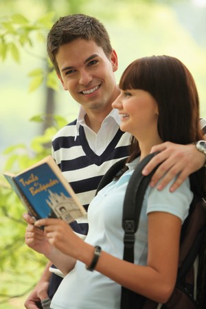 south eastern european descent: Man and woman reading book outdoors