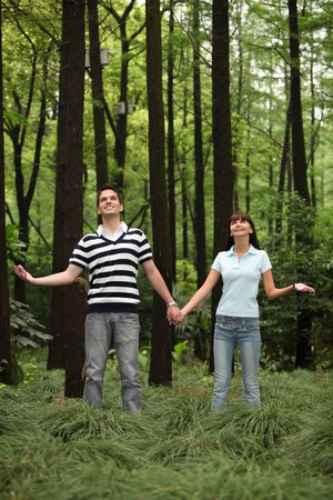 Man and woman holding hands in the forest Stock Photo - 8149347