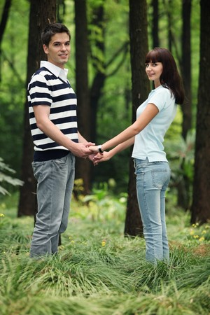 Man and woman holding hands in the forest Stock Photo - 8149224