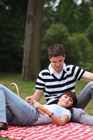 Man and woman having a picnic Stock Photo - 8148490
