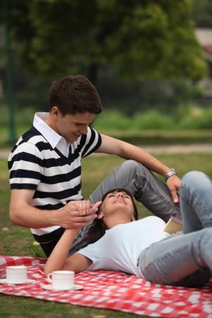 Man and woman having a picnic Stock Photo - 8148350
