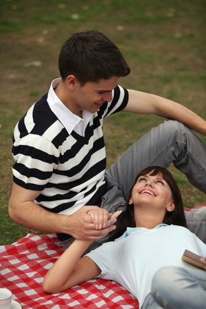 Man and woman having a picnic photo