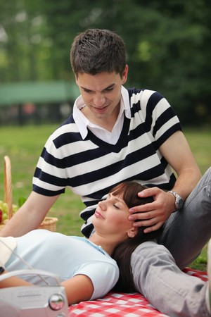 south eastern european descent: Man and woman having a picnic