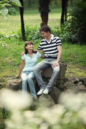 Man and woman sitting on the rocks Stock Photo - 8149246