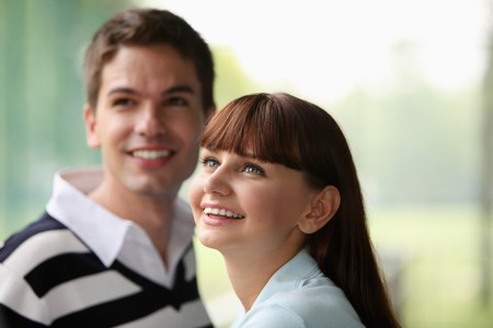 south western european descent: Man and woman looking up and smiling